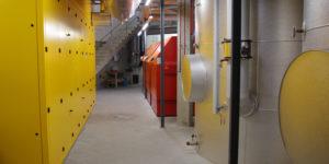 BHKW, zwei Pufferspeicher und drei Gaskessel zur Spitzenlastabdeckung bilden eine stabile, sichere Versorgung mit Wärme und Strom.